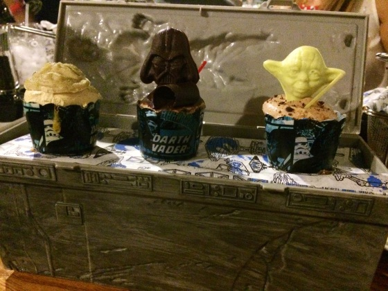 Trio of Star Wars mini cupcakes, including Mini Darth Vader (chocolate-peanut butter), Mini Yoda (chocolate-hazelnut), and Mini Jabba the Hutt (salted caramel latte) served in the Han Solo Carbonite Souvenir Box